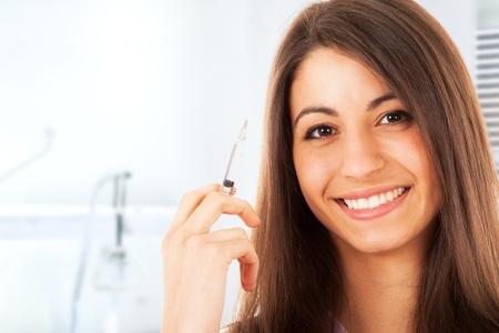 Portrait of a nurse holding a syringe Stock Photo - 16408644