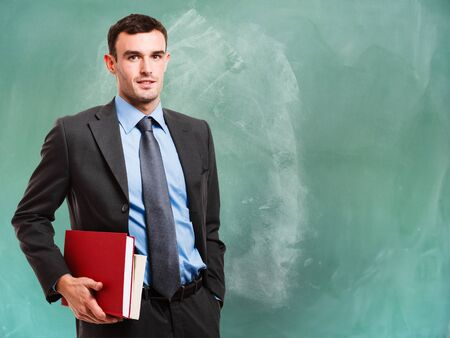 councilor: Portrait of a man in front of a chalkboard