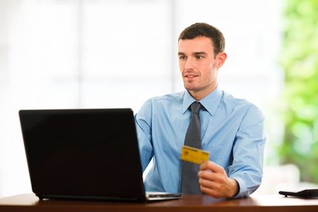Portrait of a man using a credit card for online shopping Stock Photo - 16408600