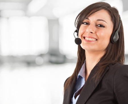 helpdesk: Portrait of a beautiful girl with headset Stock Photo