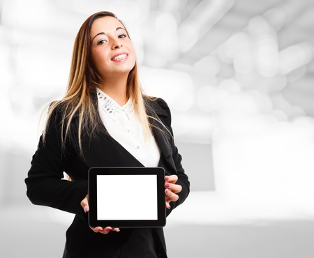 Smiling woman holding a tablet photo