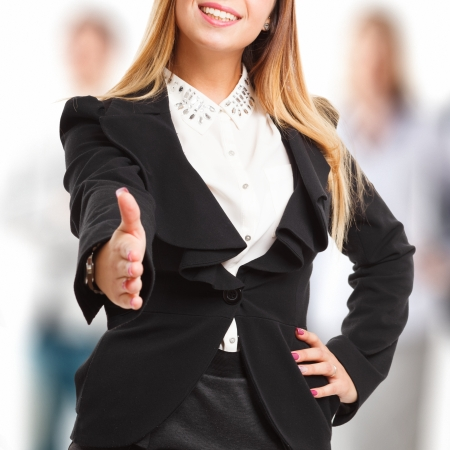 Business woman offering an handshake Stock Photo