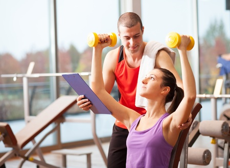 fitness club: Woman working out in a fitness club