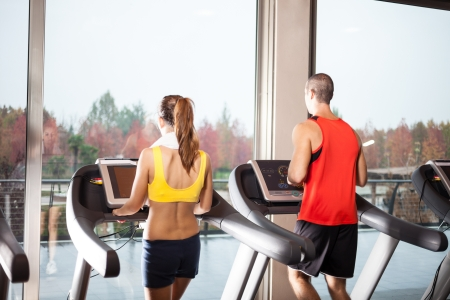 fitness club: People running on treadmills in a fitness club