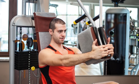 fitness club: Man working out in a fitness club