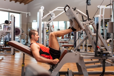 press: Man working out in a fitness club