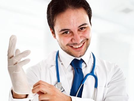 colon: Ritratto di un medico amichevole indossa un guanto Archivio Fotografico