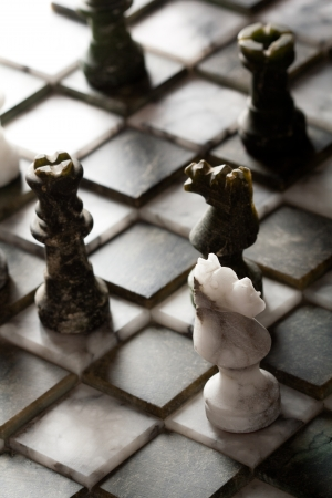 chess player: Chess pieces on a marble board Stock Photo