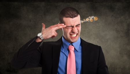 business problems: Conceptual image of a businessman shooting himself for business problems Stock Photo
