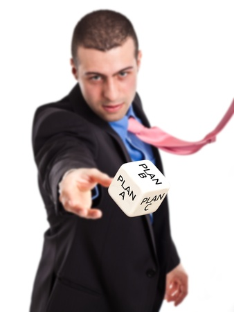 rolling dice: Confident businessman rolling a dice Stock Photo