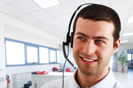 call us: Portrait of a young and happy phone operator