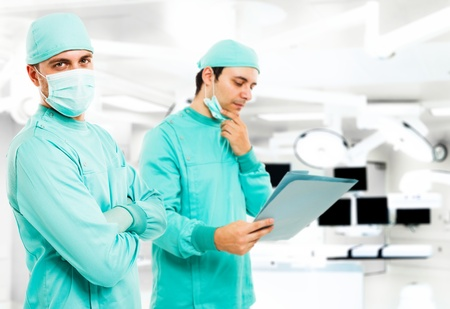 Portrait of two surgeons in a operating theatre photo