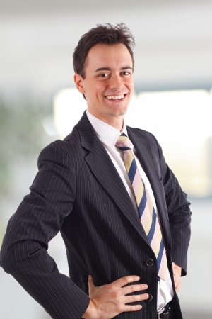 Young businessman smiling in his office photo
