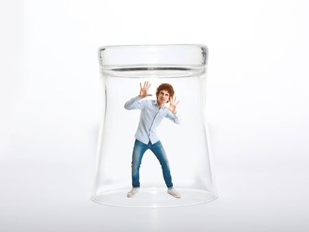 Young man trying to escape from a glass Stock Photo - 16671638