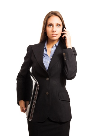 Businesswoman talking on the phone while holding her laptop Stock Photo - 16599305