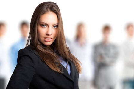 gorgeous businesswoman: Portrait of a smiling beautiful businesswoman in front of her team