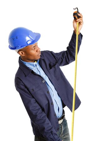 building contractor: Portrait of a worker using a tape