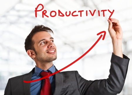 Friendly businessman writing the word Productivity and a rising arrow photo