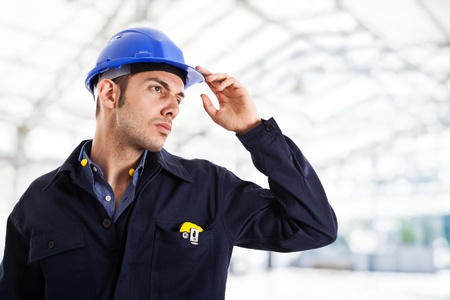 hard workers: Engineer working in a construction site Stock Photo