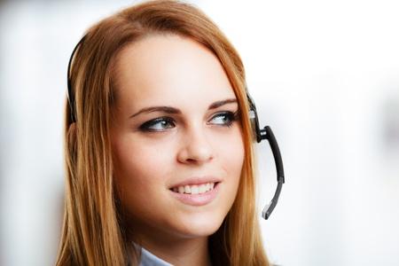 call us: Portrait of a smiling customer representative