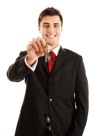 Portrait of an agent giving you keys. Isolated on white photo