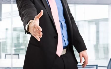 Businessman offering an handshake