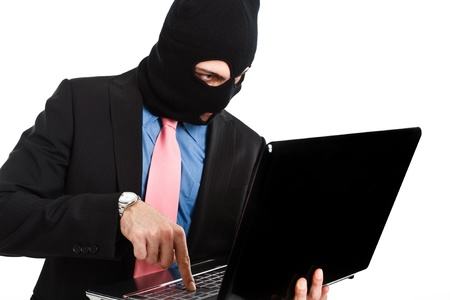 insider information: Hacker using a notebook
