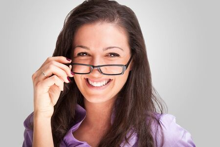 eyesight: Portrait of a young woman holding her eyeglasses