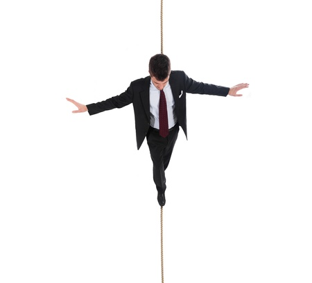 troubles: Businessman walking on a rope Stock Photo