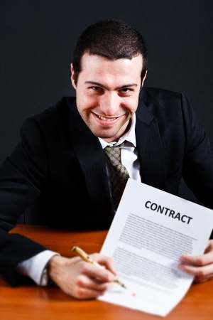 loaning: Dishonest businessman asking for signature on a contract