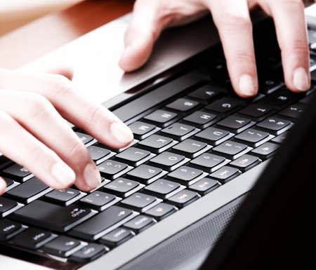 Hands typing on a laptop  Focus on the keyboard  Stock Photo - 16754285