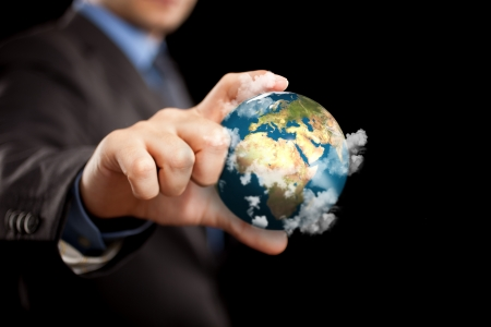 merciless: Businessman holding the world in the fingers