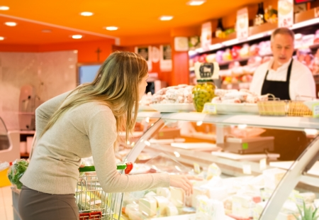 delicatessen: Woman shopping at the supermarket