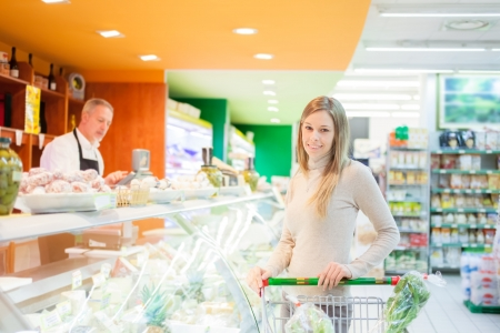 Woman shopping in a supermarket Stock Photo - 16732861