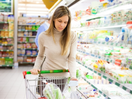 Woman shopping at the supermarket Stock Photo - 16732865