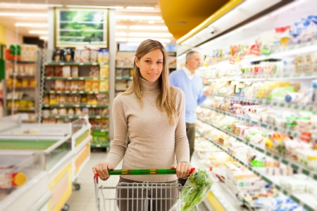 Woman shopping at the supermarket photo