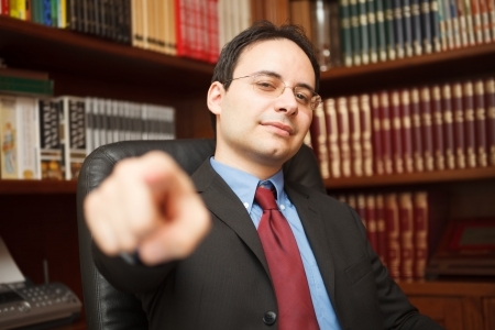 Confident businessman pointing his finger photo