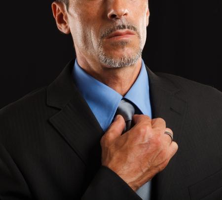 Businessman adjusting his necktie Stock Photo - 17184255