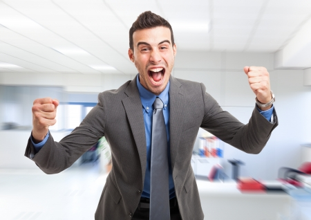 succesful: Portrait of a very happy business man in his office