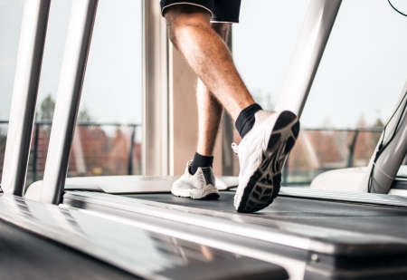 gymnasium: Man running on a treadmill