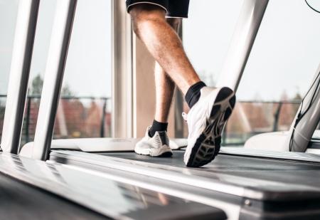 treadmill: Man running on a treadmill
