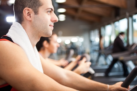 Young man training in a fitness club Stock Photo - 17184450