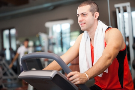 sports hall: Young man training in a fitness club