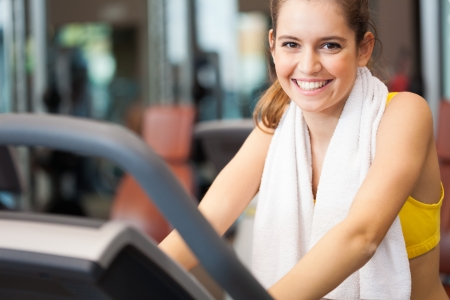 Portrait of a smiling woman training in a fitness club photo