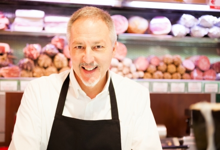 Shopkeeper smiling in a grocery store photo