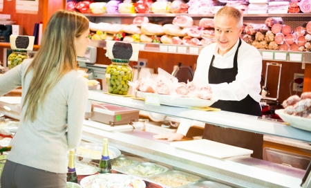 Shopkeeper serving a customer in a grocery store Stock Photo - 17184463