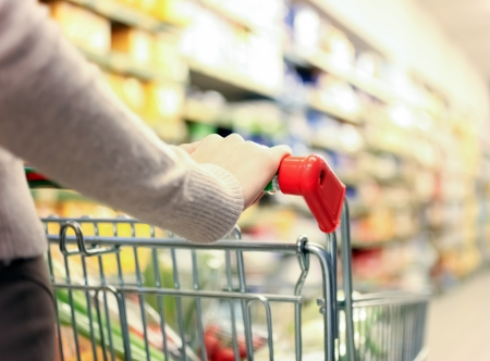 woman shopping cart: Woman shopping at the supermarket