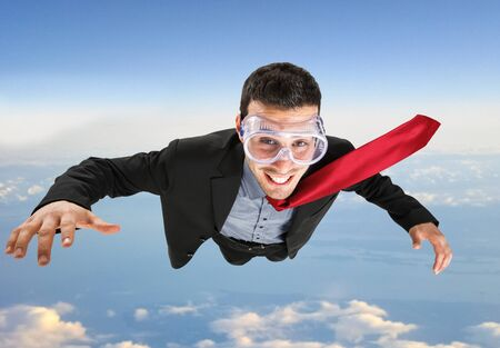 skydive: Portrait of a funny businessman skydiving Stock Photo