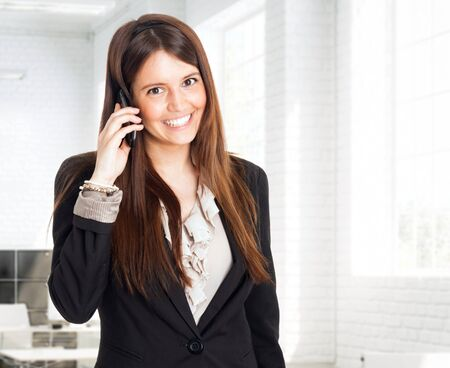 Portrait of a beautiful woman talking on the mobile phone Stock Photo - 17184464