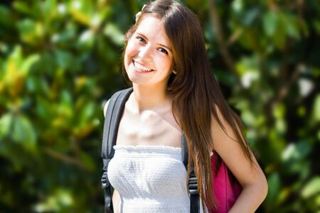 pretty teen girl: Portrait of a young smiling student